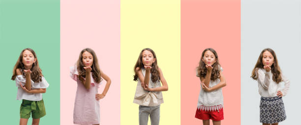 collage of brunette hispanic girl wearing different outfits looking at the camera blowing a kiss with hand on air being lovely. love expression. - kiss стоковые фото и изображения