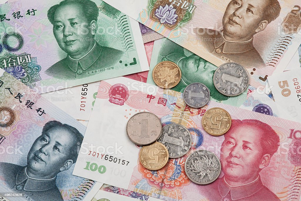 Collage of Chinese RMB bank notes and coins stock photo