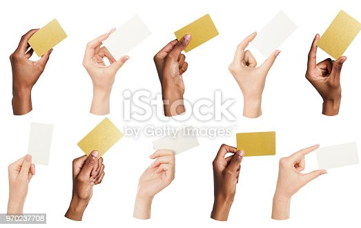 Set of multiethnic hands holding empty business cards isolated on white background, copy space