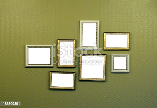 istock Collage of empty picture frames hanging on wall 183805391