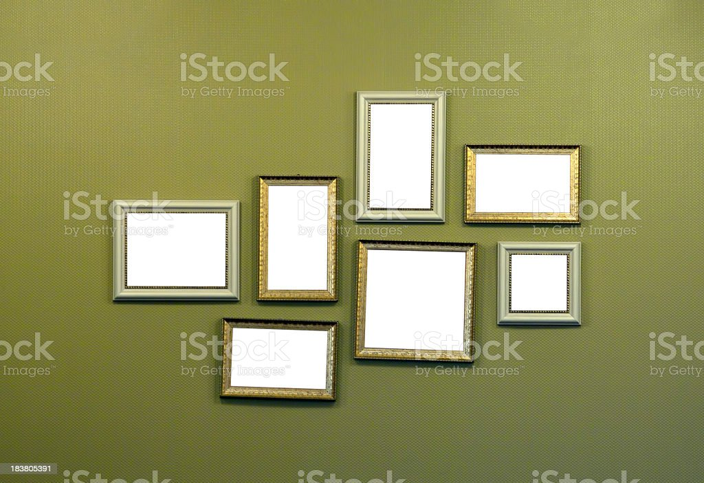 Collage of empty picture frames hanging on wall stock photo