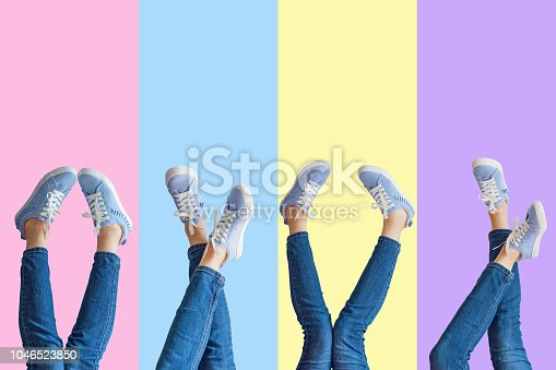 istock Collage of female legs in jeans and sneakers on colored background 1046523850