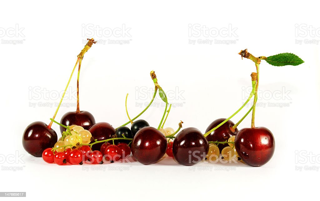 collage of fruits and berries (horizontal row: cherry, currant, bilberry) royalty-free stock photo