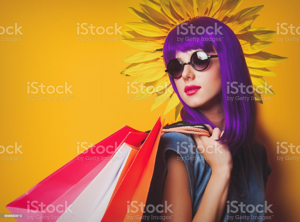 Collage of girl with bags and sunflower stock photo
