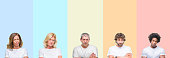 Collage of group of young and middle age people wearing white t-shirt over color isolated background skeptic and nervous, disapproving expression on face with crossed arms. Negative person.