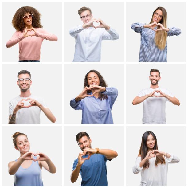 一群年輕的女人和男人在白色的鞋底背景上微笑著在愛中展示心靈的象徵和形狀用手。浪漫的概念。 - 中等人數群 個照片及圖片檔