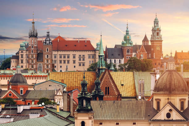 collage of krakow landmarks in the evening - poland stock photos and pictures