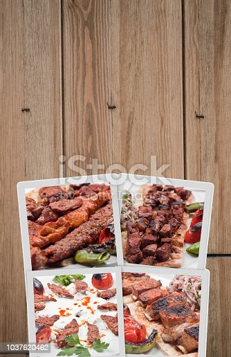 istock Collage of mixed Turkish Kebab on wood table 1037620462