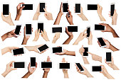 istock Collage of multiethnic hands holding mobile, isolated on white 970235958