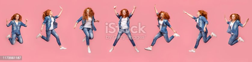 istock Collage of redhead girl jumping in air on pink background 1173561187