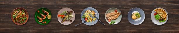 collage von restaurant gerichte auf hölzernen hintergrund - käse wurst salat stock-fotos und bilder