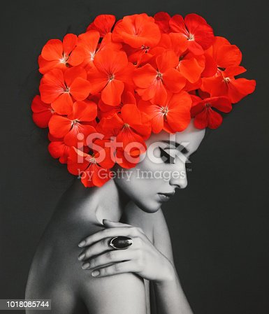 Analog collage with black and white female portrait and red flowers