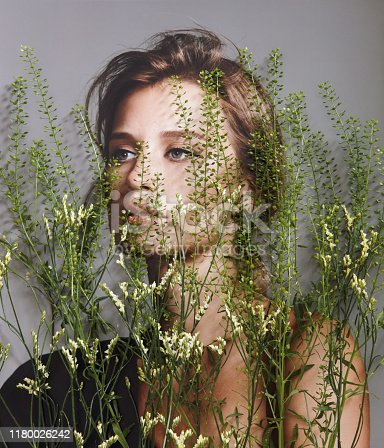 istock Collage with female portrait and plants 1180026242