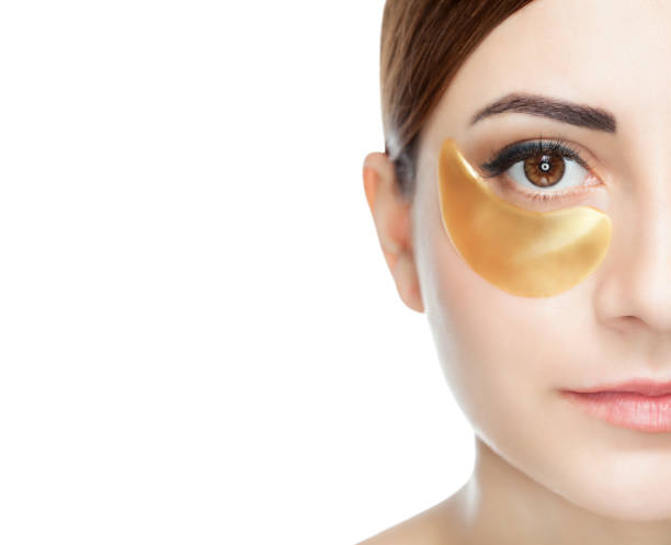 Collagen gold patches on the skin of the eyelid, on the face Collagen gold patches on the skin of the eyelid, on the face of a beautiful woman. costume eye patch stock pictures, royalty-free photos & images