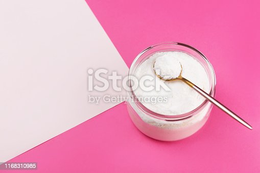 istock Collagen powder on pink background. 1168310985