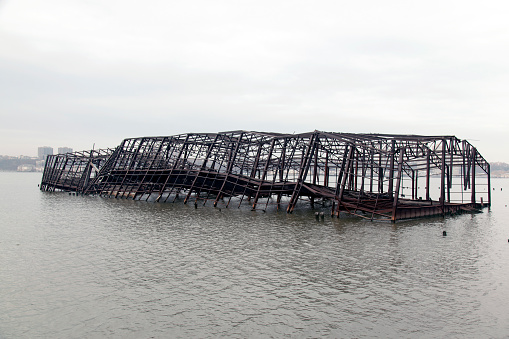 Collapsed metal built structure of a pier in the river