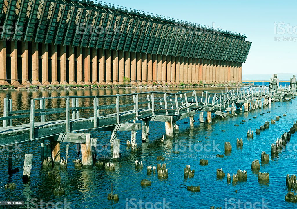 Collapsed walkway and ore dock on Lake Superior in Michigan stock photo