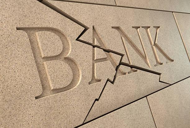 倒れる銀行サイン ストックフォト