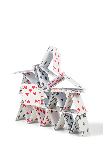 Collapsing House Of Cards Stock Photo - Download Image Now