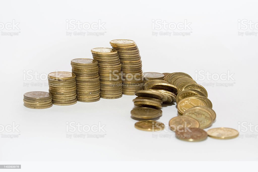 Collapsing stacks of coins royalty-free stock photo