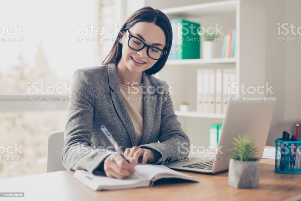 Collar executive love to work concept. Portrait of pretty perspective intelligent clever responsible expert experienced qualified freelancer writing down thoughts plans project into book stock photo
