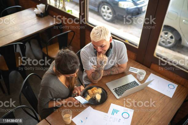 Colleagues analyzing some data from digital investment on mobile and picture id1154384315?b=1&k=6&m=1154384315&s=612x612&h=n9vpr av hkia4n2stbtglcui5 xe94k iqay338sqw=