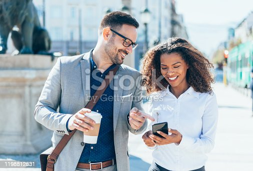 Modern elegant Coworkers Chatting together In City Street in their way to work