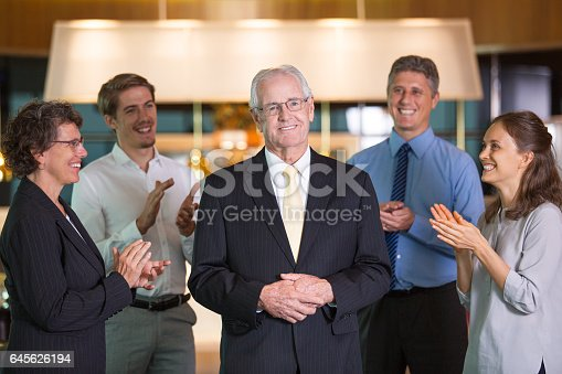 istock Colleagues Applauding to Senior Business Leader 645626194