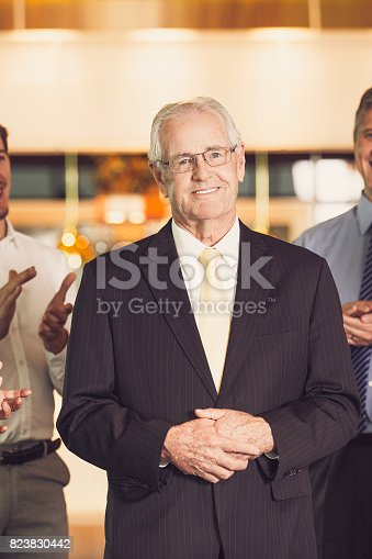 istock Colleagues Applauding to Senior Business Leader 823830442