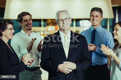 istock Colleagues Applauding to Senior Business Leader 966327106