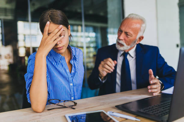 Colleagues arguing at workplace Two business people arguin at the office harassment stock pictures, royalty-free photos & images