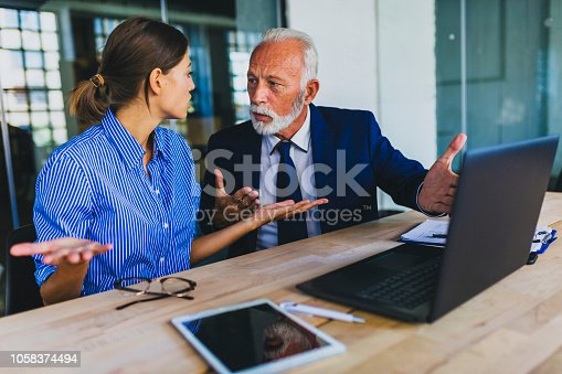 Two business people arguin at the officeTwo business people arguin at the office