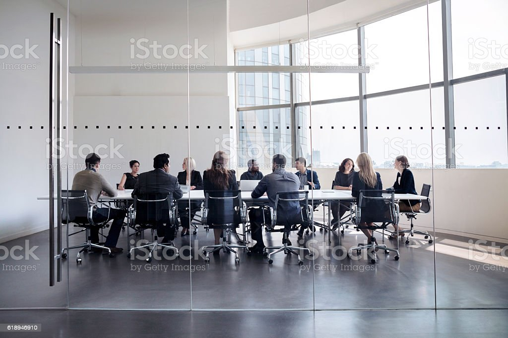 Colleagues at business meeting in conference room bildbanksfoto