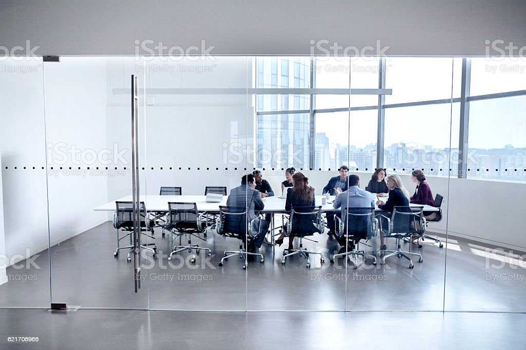 Colleagues at business meeting in conference room stock photo