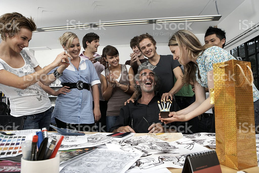Colleagues celebrating the birthday of their boss royalty free stockfoto