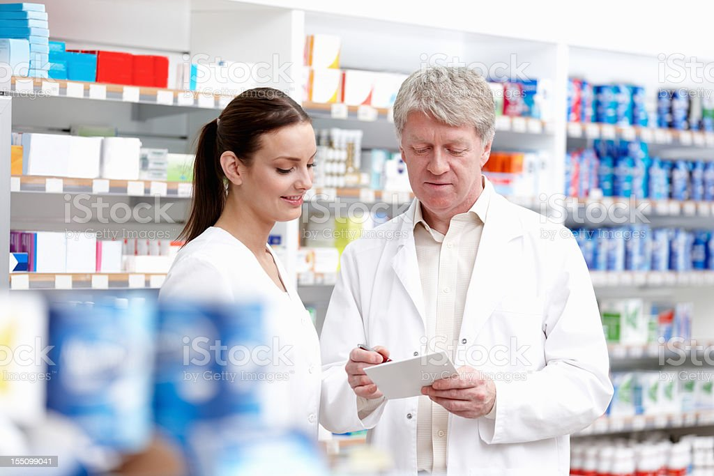 Colleagues checking a prescription royalty-free stock photo