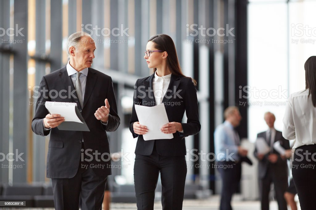 Colleagues consulting stock photo