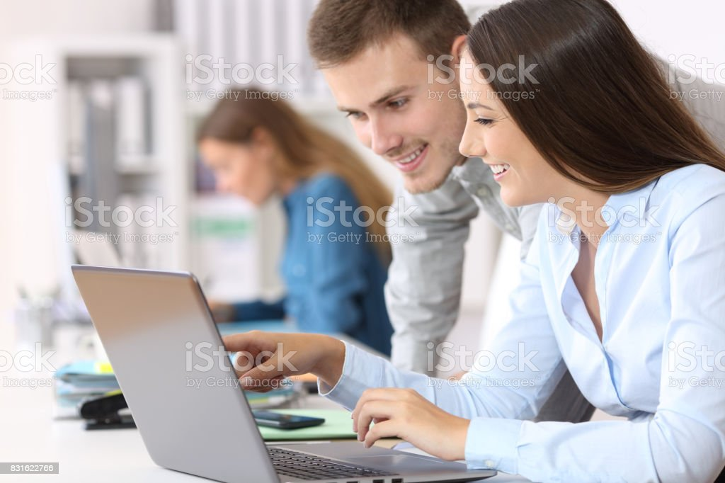 Colleagues coworking on line at office stock photo