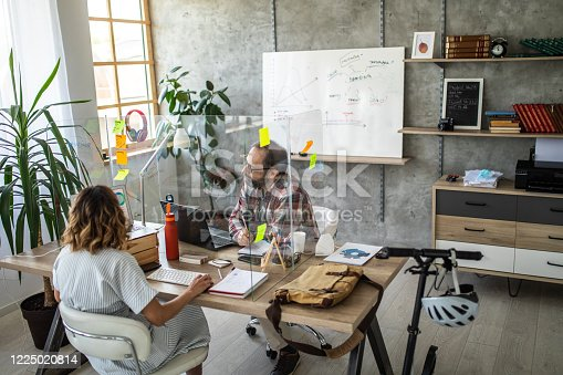 istock Colleagues discussing about business strategy at modern office 1225020814
