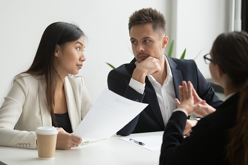 istock Colleagues discussing job applicant resume 955158590