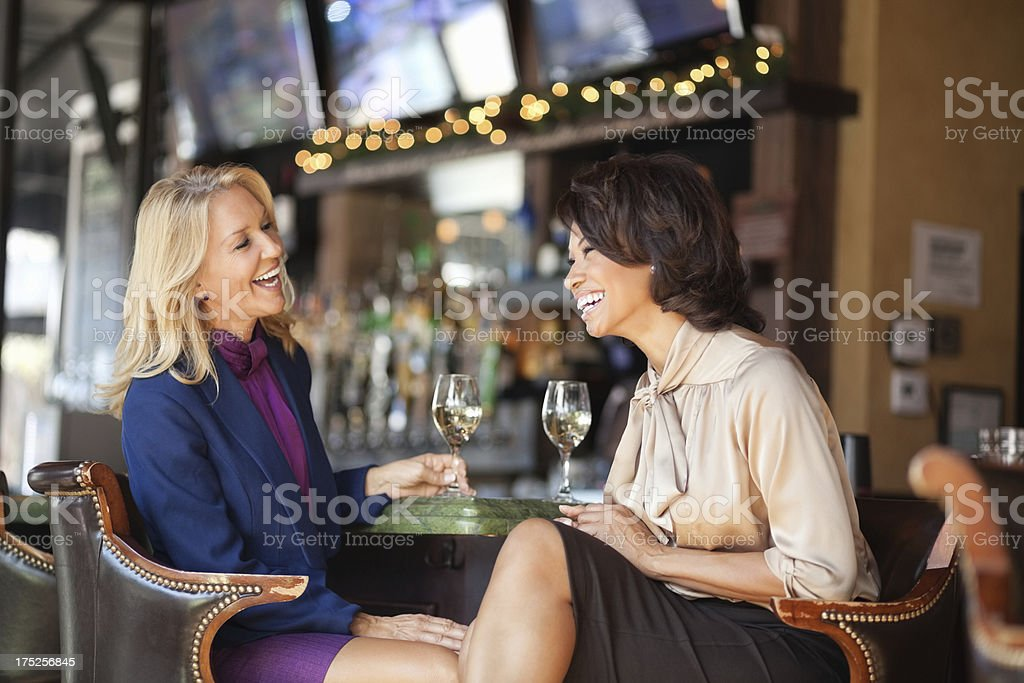 Colleagues Enjoying Drinks At Restaurant royalty-free stock photo