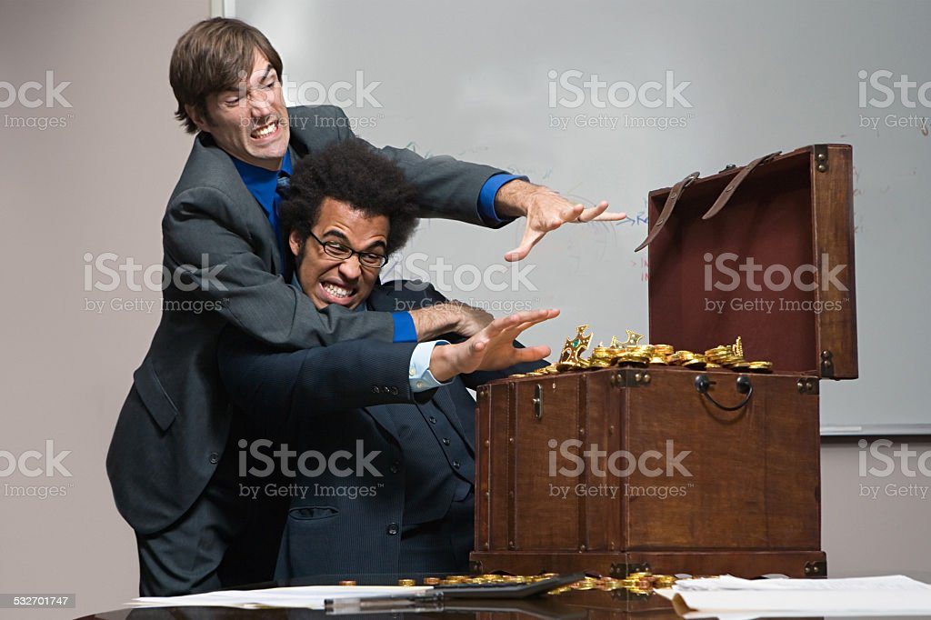 Colleagues fighting over money stock photo