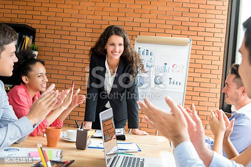 924519152 istock photo Colleagues giving the applause to  businesswoman leader in team meeting 952643818