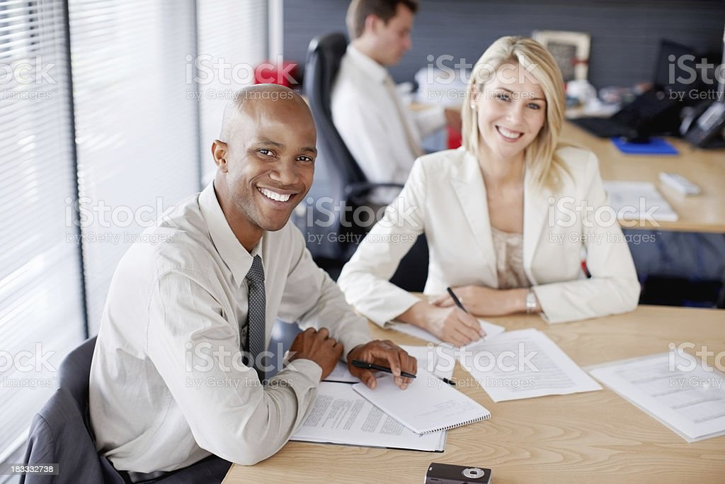 Colleagues giving you a casual smile royalty-free stock photo