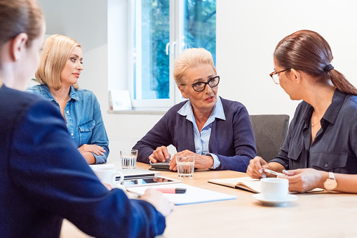 Colleagues Having Business Discussion In Meeting Stock Photo - Download Image Now