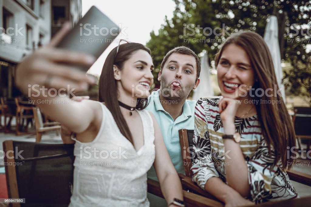 Colleagues Having Fun After Work In Local Bar stock photo