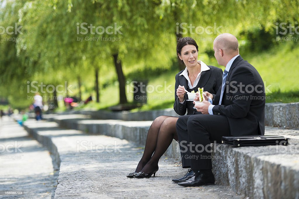 Colleagues Having Lunch Break in the Park stock photo
