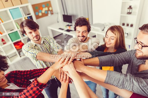istock Colleagues high fiving in the office 518872602