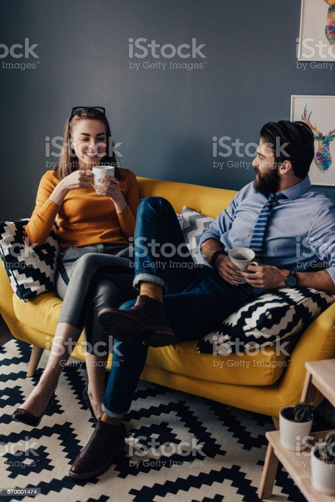 Colleagues in a break room drinking coffee