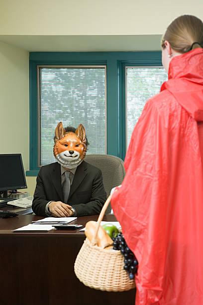 kollegen in kostüm - rotkäppchen kostüm stock-fotos und bilder